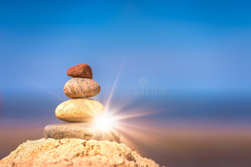 Small pile of balanced stones stock images