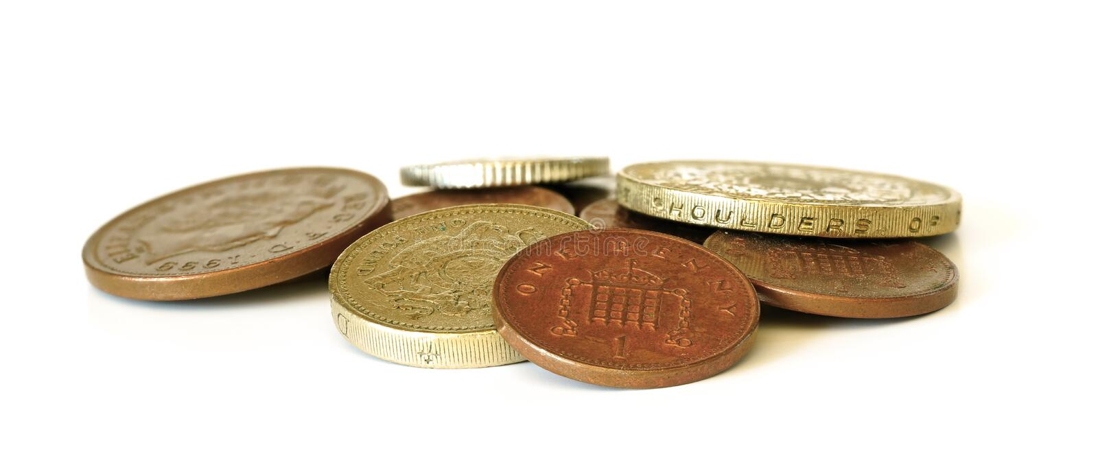 Small pile of British coins isolated on white background, closeup detail royalty free stock image