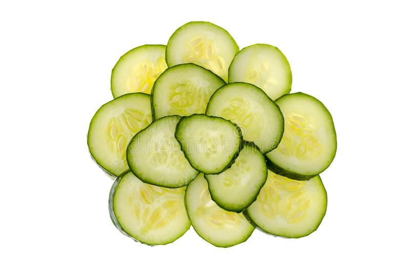 Small pile of sliced slices of fresh green cucumber isolated on white background. stock image
