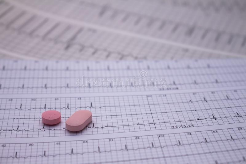 Small drugs for legal use on strips of electrocardiograms royalty free stock photography