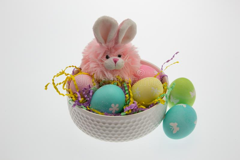 Pink Easter Bunny with Hand Dyed Eggs stock photography