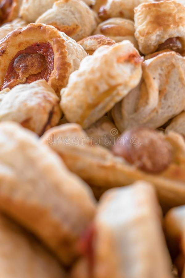 Small pizzas. Mix of delicious appetizers. Small pizzas made of puff pastry. Selective focus stock images