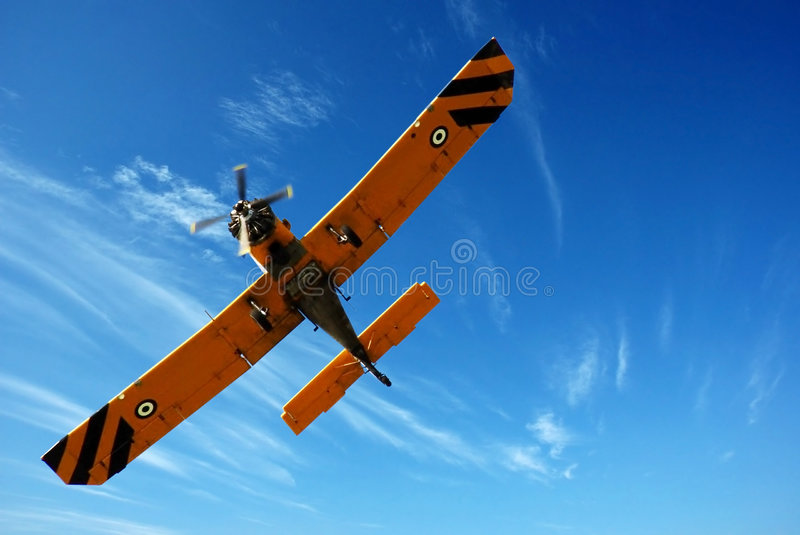 Small plane in blue sky royalty free stock photos