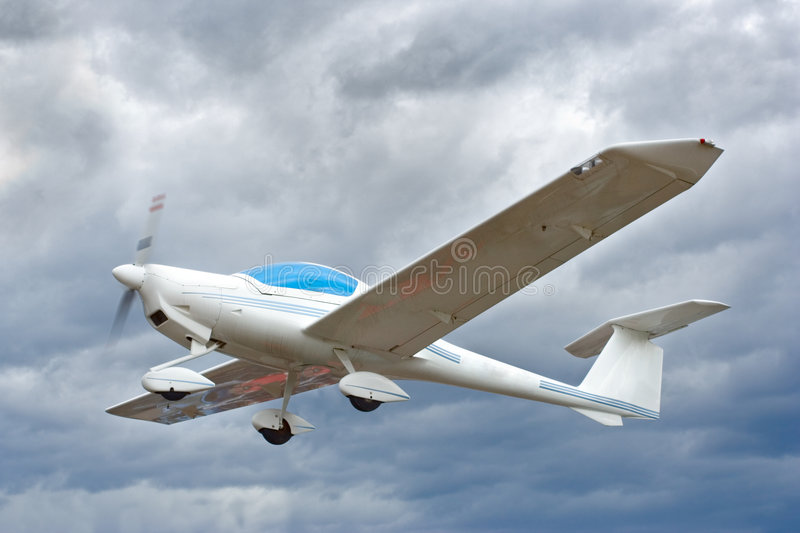 Small plane in flight stock photography
