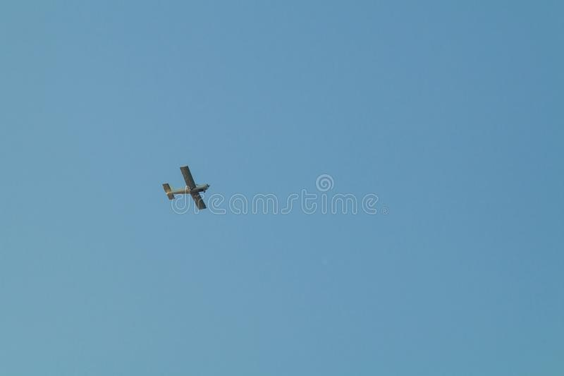 Small plane flying low in the sky stock photography