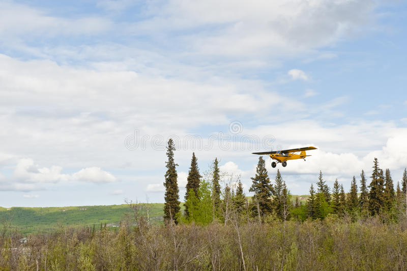 Small plane flying over Alaska royalty free stock photography