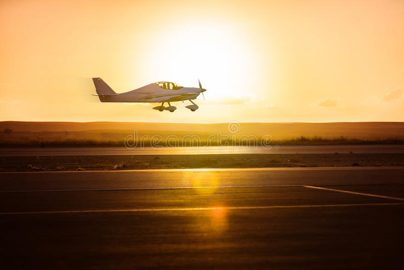 Small plane on the runway royalty free stock images