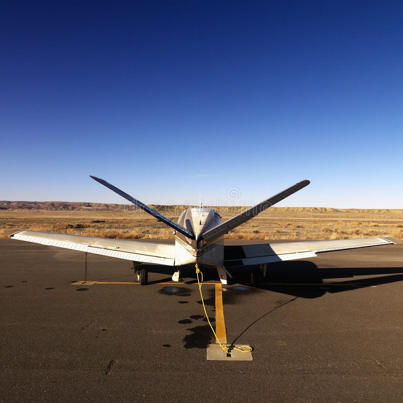 Download Small Plane On Tarmac At Airport. Royalty Free Stock Photos - Image: 6150288