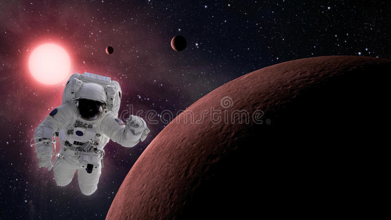 Small planetary system with astronaut in space royalty free stock photo