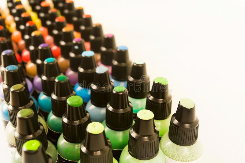 Small plastic bottles with colorful paint for arts with samples. On cover with copy space, soft focus stock photos