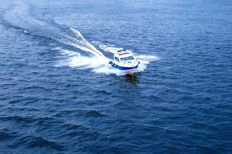 Small police boat at speed.  stock photos