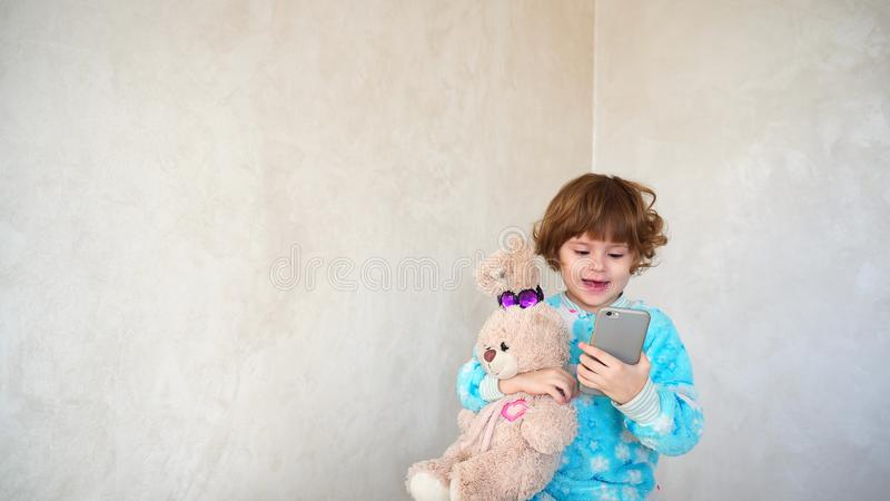 Small Polish girl studying possibilities of smartphone. royalty free stock photos