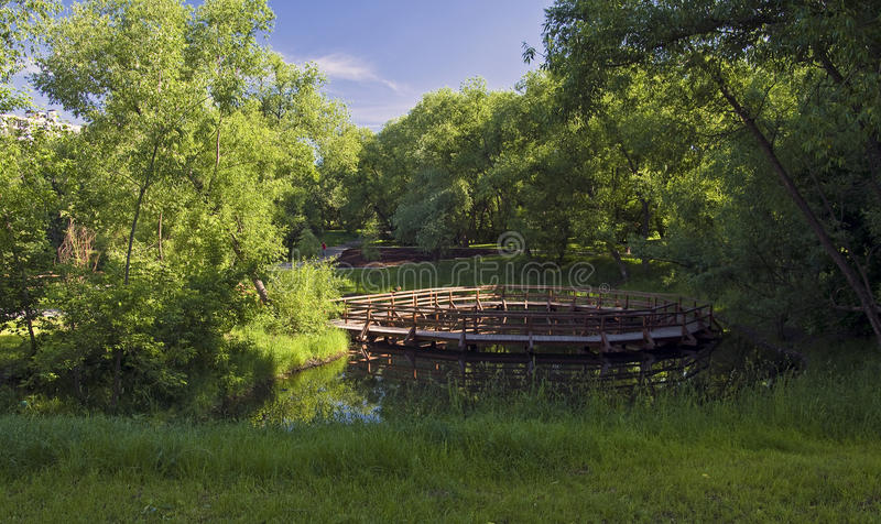 Download A small pond in the city. stock image. Image of footbridge - 25491133