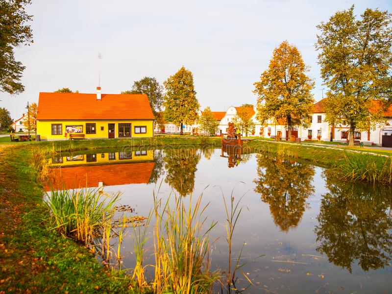 Small pond in the middle of Holasovice - traditional Czech village, Czech Republic. UNESCO World Heritage Site stock photos