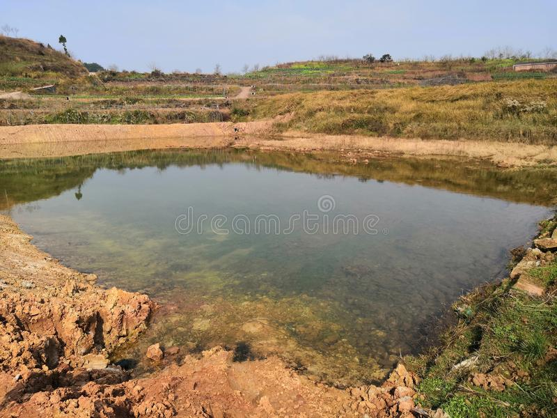 Small pond in the wild. The time is in the late winter and early spring, the frost makes the pond look desolate, but the pond`s melting water is exceptionally stock images