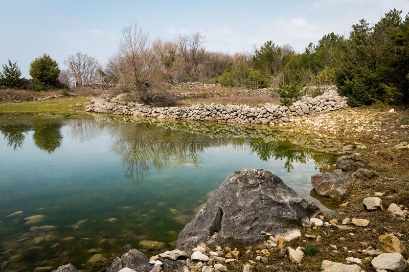 Small ponds watering place for sheep in spring near Lubenice. Cres Croatia stock image