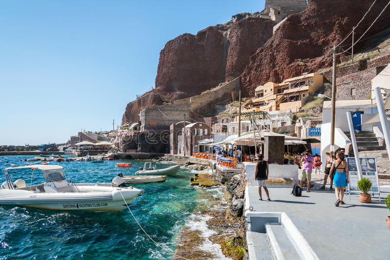 Small port of Oia town with many tourists on Santorini island, Greece royalty free stock photo