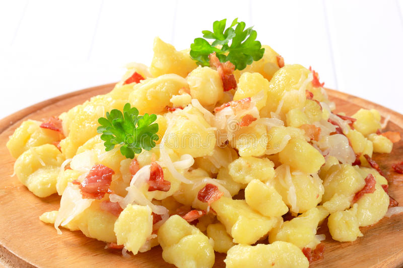 Small potato dumplings with bacon and cabbage. Small potato dumplings with bacon and white cabbage stock photos