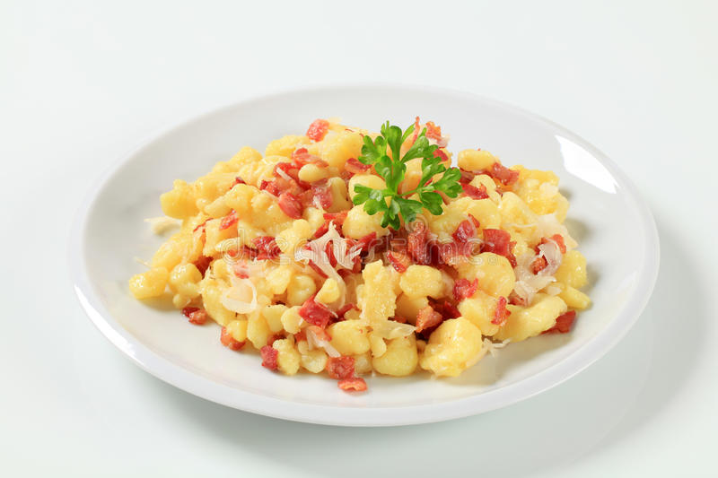 Small potato dumplings with bacon and cabbage. Small potato dumplings with bacon and white cabbage stock image