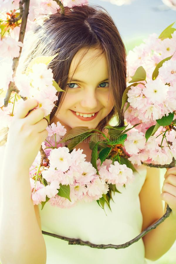 Small pretty girl in blossom royalty free stock photo