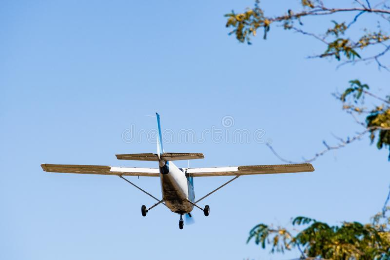 Small, private airplane preparing to land at a regional airport in South San Francisco bay area, California; space for copy on the. Upper left side; tree stock photos