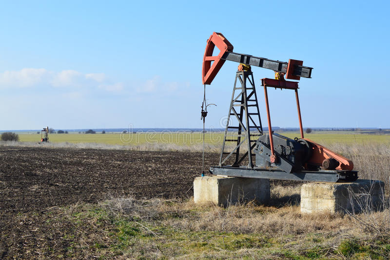 Small Pump Jack in agricultural field stock images