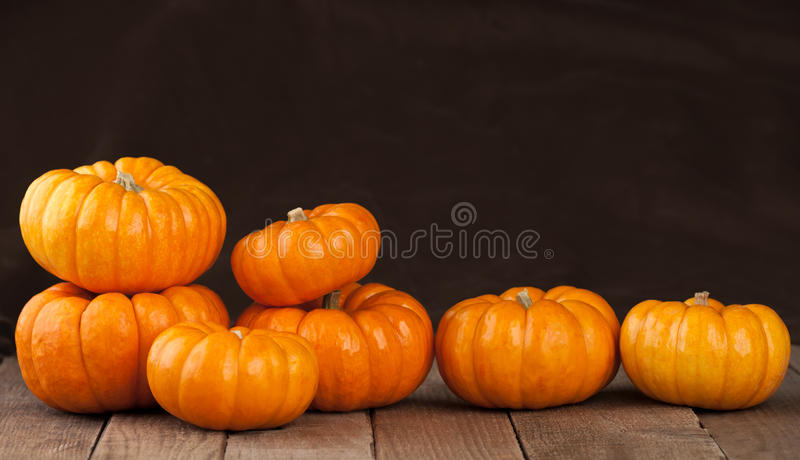 Small Pumpkins on Rustic Wooden Boards