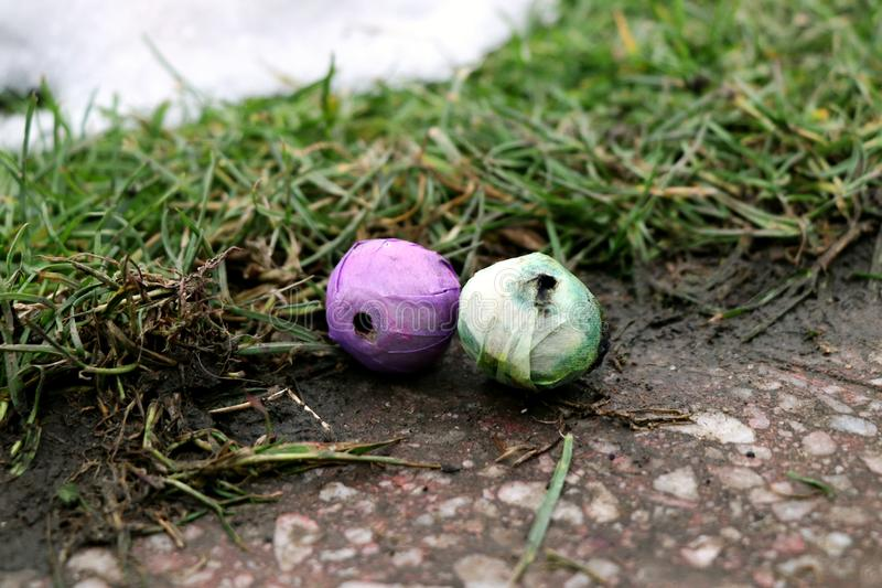 The small purple and green pyrotechnics balls. The small green and purple pyrotechnics balls royalty free stock photo