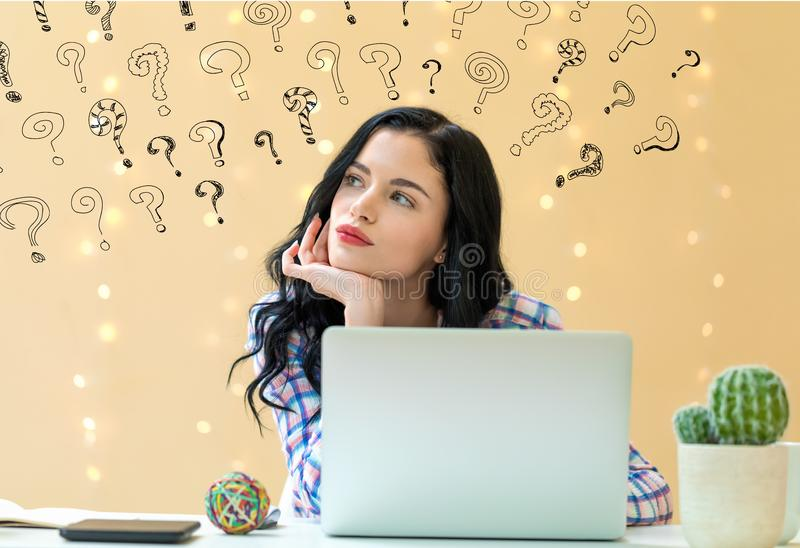 Small question marks with young woman royalty free stock photo