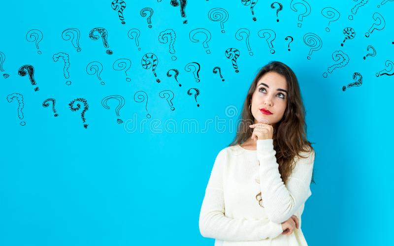 Small question marks with young woman royalty free stock photography
