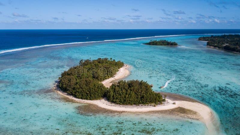 Small Rarotonga islands in a small blue lagoon stock photos