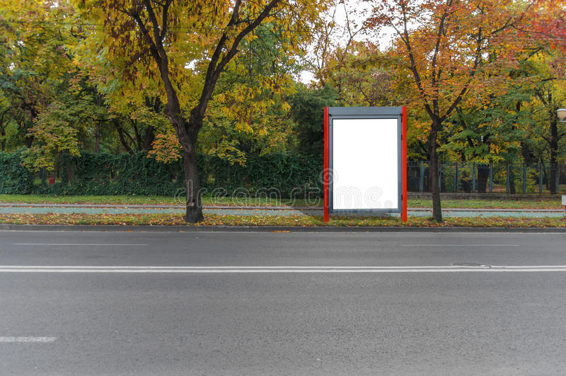 Small red blank billboard for media business advert on street stock images