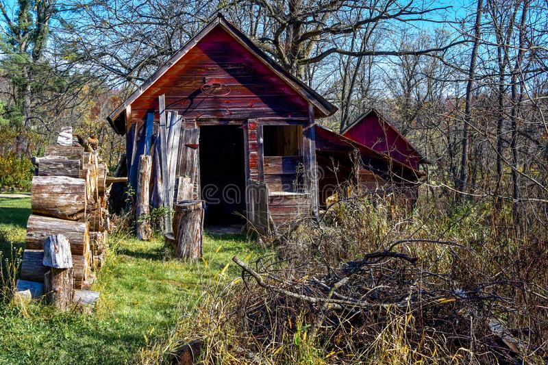 Small Red Cabin with Firewood stock image