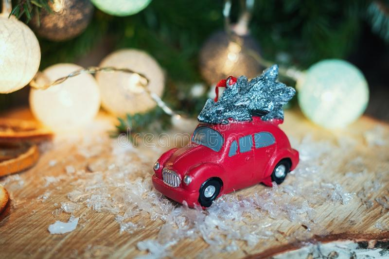 Small red car in front of a Christmas branch decorated with illuminated christmas balls. Zaandam, Netherlands, January 8, 2017: Small red car in front of a stock image