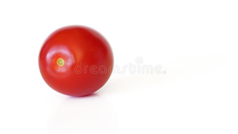 Small red cherry tomato isolated on white background, space for text right side stock images