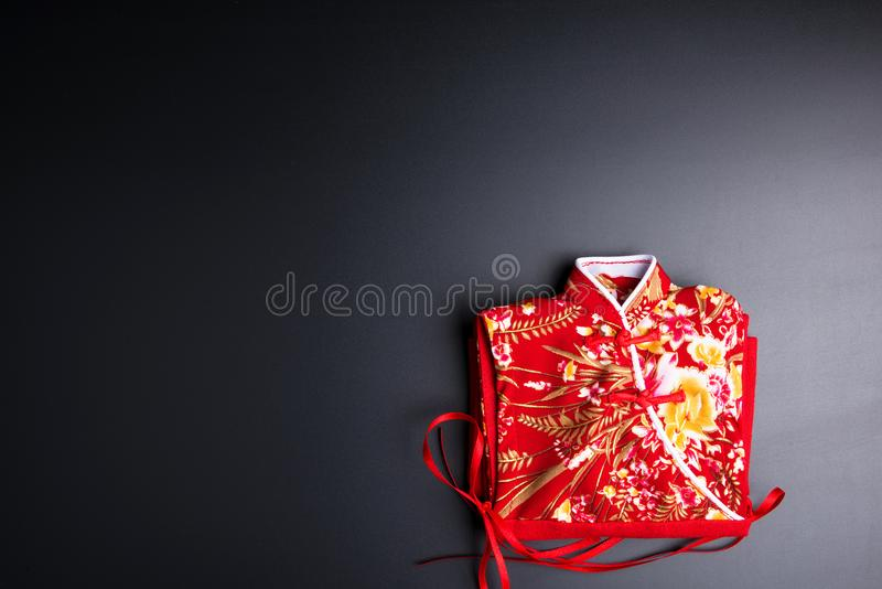 Small Red chinese women& x27;s wear on black background in chinese ne royalty free stock photography
