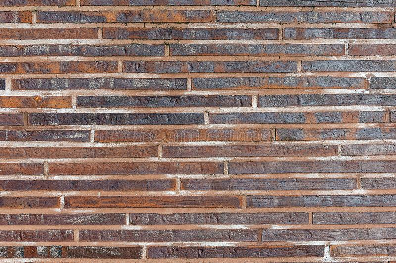 Small red clinker bricks. Background from small red clinker bricks royalty free stock photos