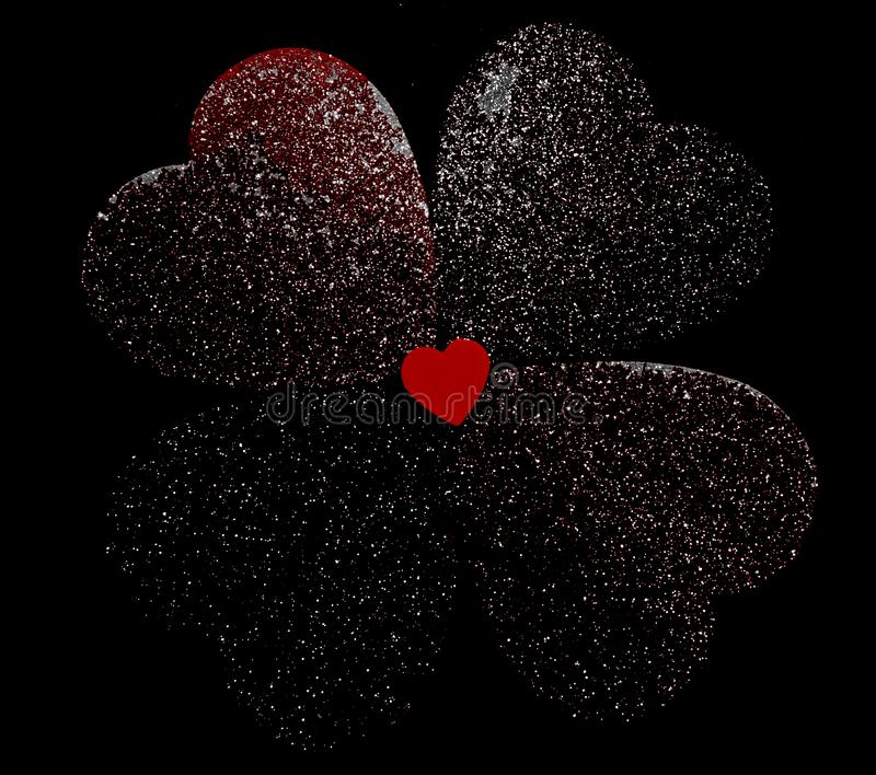 A small red heart with faded hearts behind it stock photography