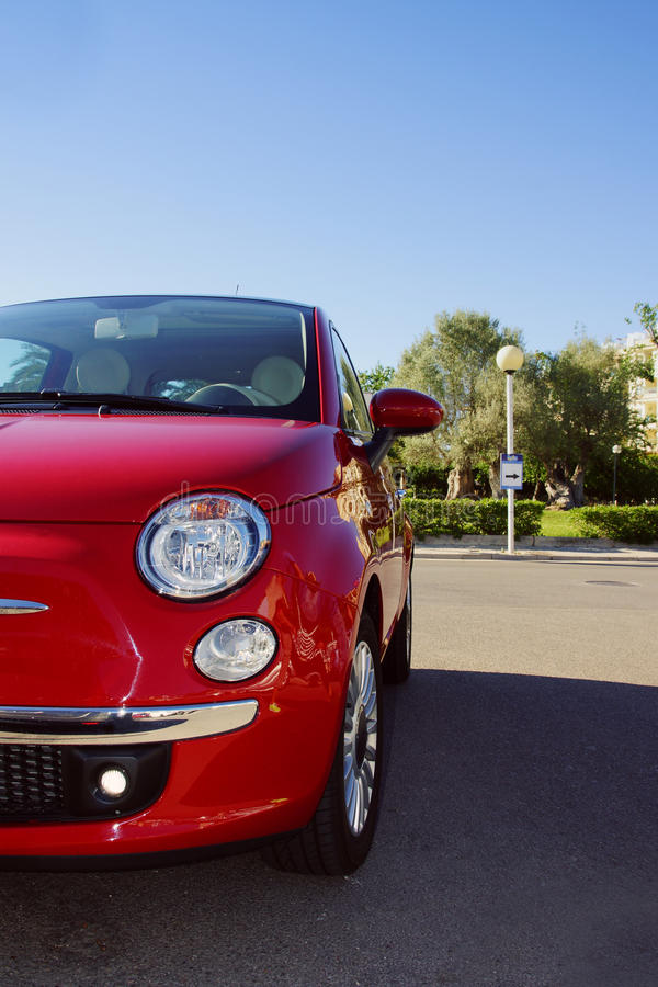Small Red Italian Car parked in the Street royalty free stock image