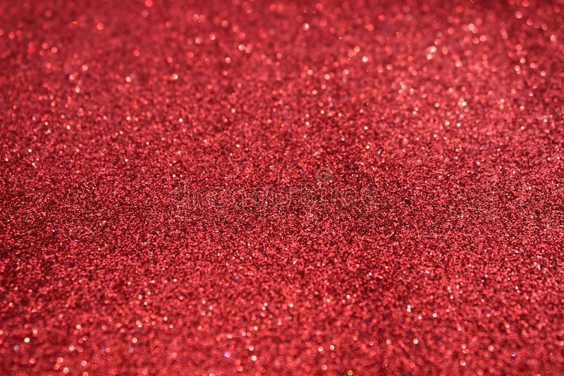 Small red sequins as background. Glitter as a background of the holiday. Beautiful red background royalty free stock photography