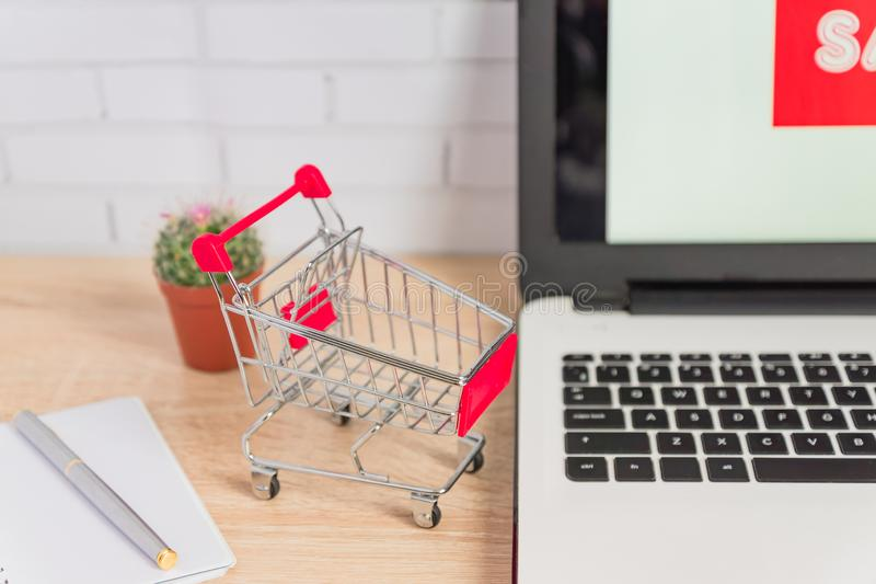 Small red shopping cart or trolley on laptop keyboard, Technology business online shopping concept.  royalty free stock photo
