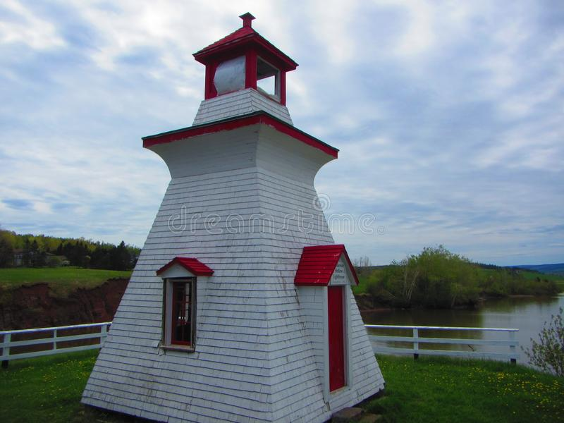 Small red and white lighthouse. Very small red and white wood construction lighthouse fundy shore, bay of fundy new brunswick. Fundy national park stock photo