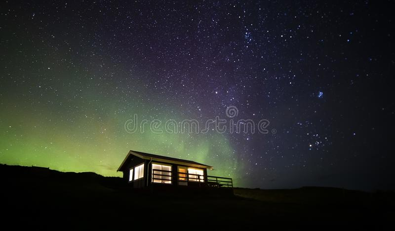 Northern lights cabin stock image