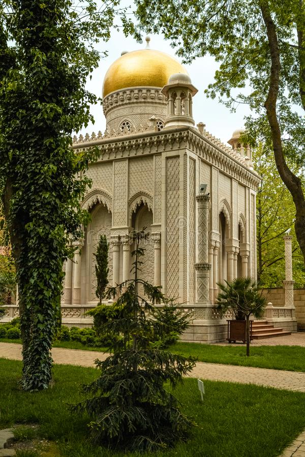Small replica of temple Taj Mahal, Kabardinka, Russia. Golden dome stock photography