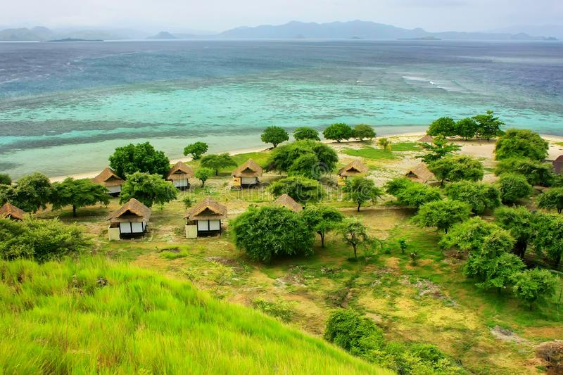 Small resort on Kanawa Island in Flores Sea, Nusa Tenggara, Indonesia. Kanawa Island is within the Komodo National Park stock images