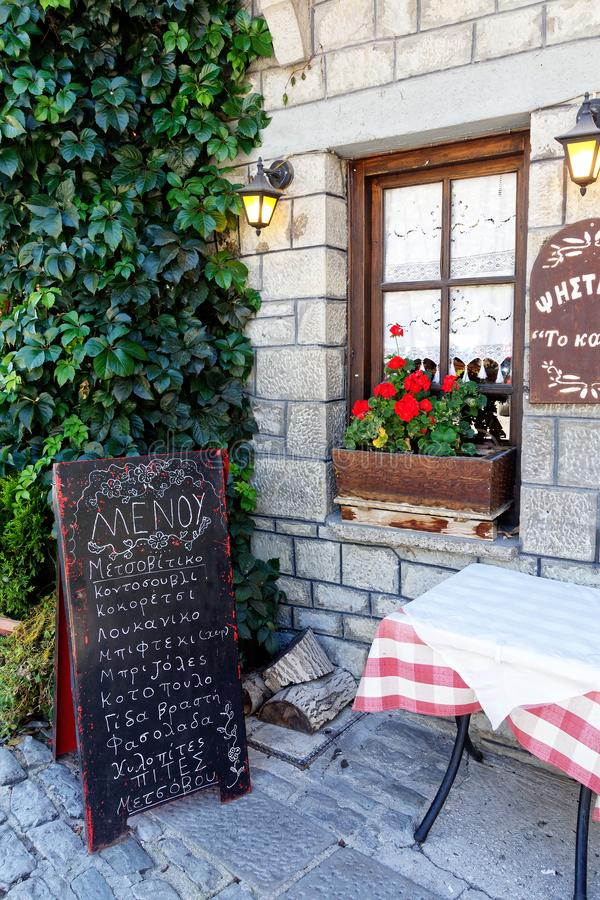 Small Restaurant, Metsovo, Epirus, Greece. A small chalk board listing menu specialities outside a small restaurant, historic Metsovo, Epirus, Greece royalty free stock photos