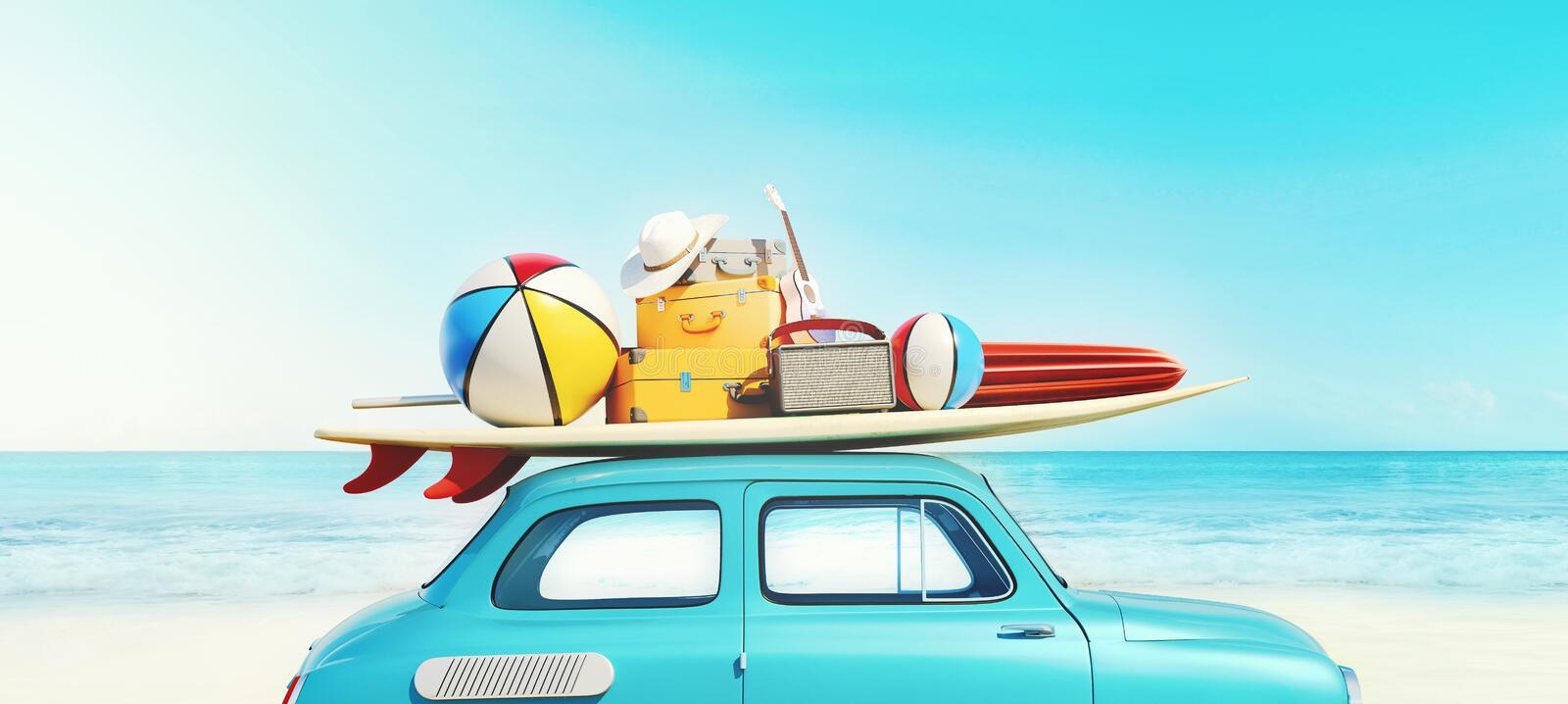 Small retro car with baggage, luggage and beach equipment on the roof, fully packed, ready for summer vacation, concept of a road stock photo