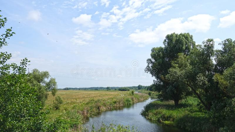 Small river in the countryside, summer day. Small river in the countryside on a summer day stock photos