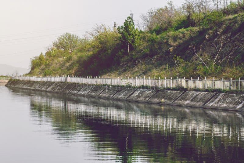 Small River Dam Concrete Wall stock photo