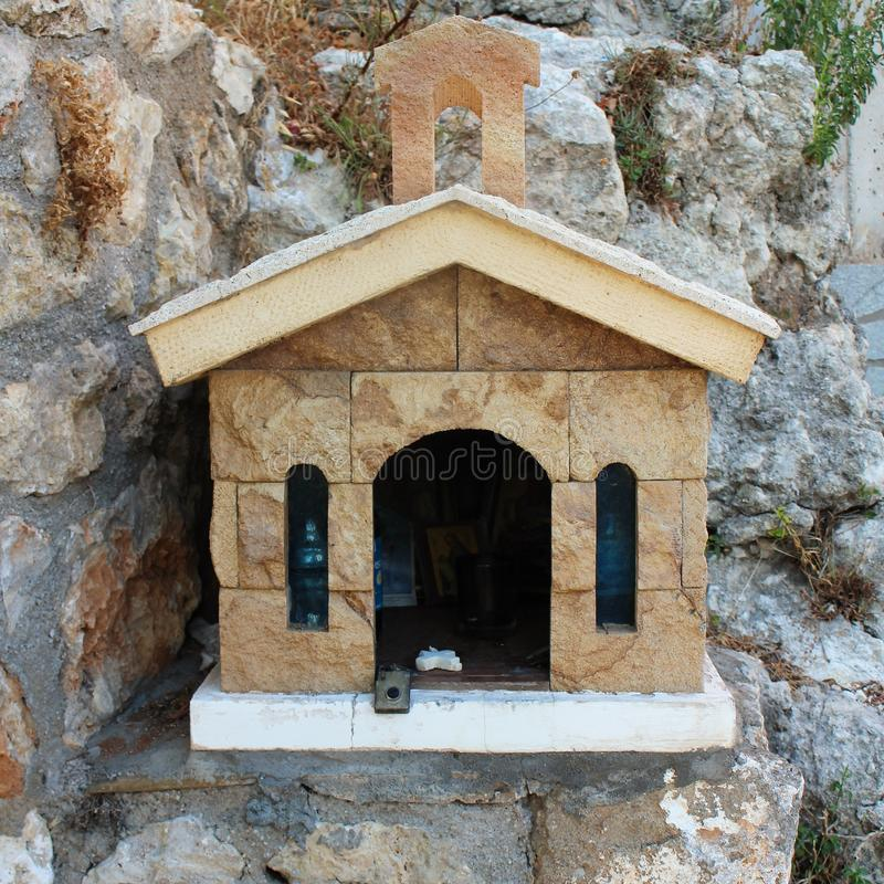 A small road church in Crete. In Greece, small chapels are built at the roadside to honor someone who lost their live on the road. Accident, altar, believe stock photos